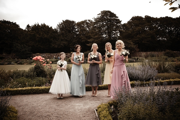 Bridesmaids posing in coloured dresses - Picture by Archibald Photography
