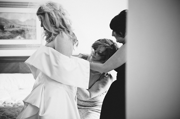Bride putting on wedding dress - Picture by McKinley-Rodgers Photography