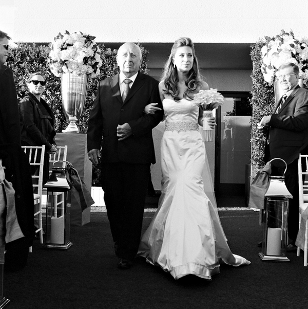 Bride walking with father into wedding ceremony - Picture by Yvette Roman Photography