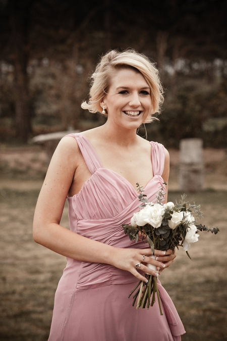 Bridesmaid in pink dress - Picture by Archibald Photography