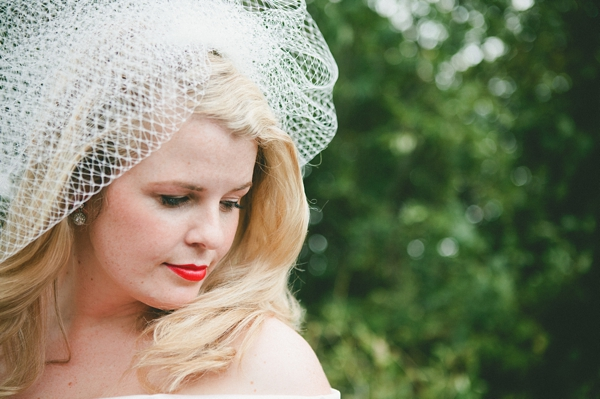 Bride wearing veil and red lipstick - Picture by McKinley-Rodgers Photography