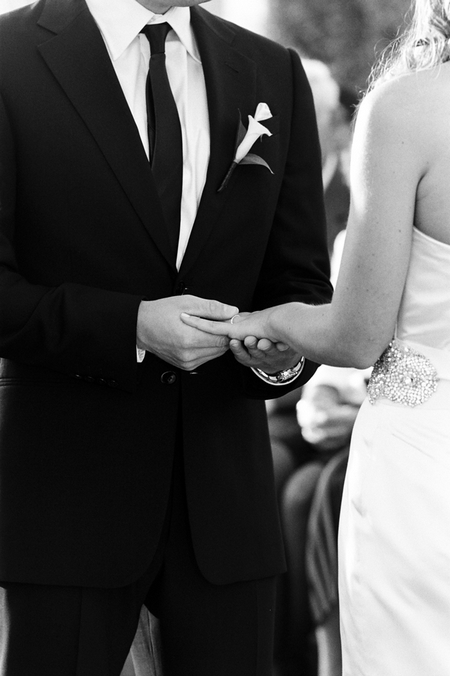 Groom placing ring on bride's finger - Picture by Yvette Roman Photography