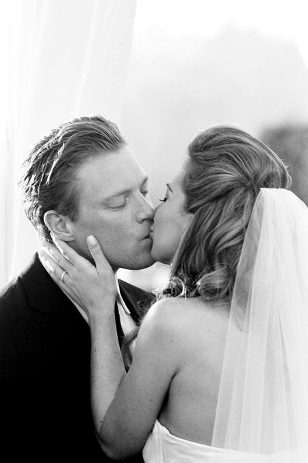 Bride and groom's first kiss - Picture by Yvette Roman Photography