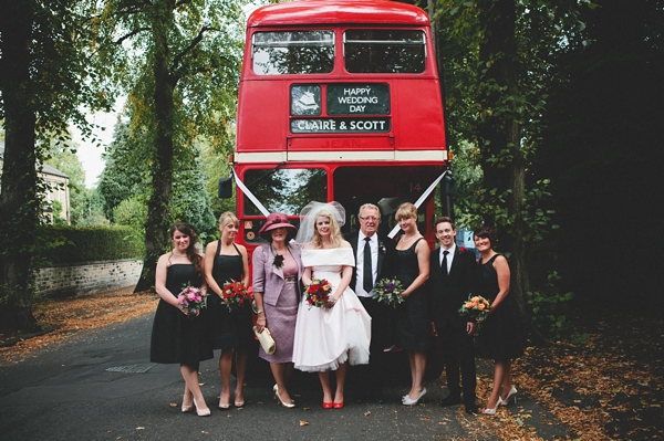Bridal party in front of red bus - Picture by McKinley-Rodgers Photography