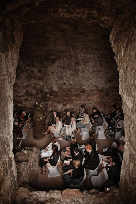 Wedding guests waiting in ceremony room at Dirleton Castle - Picture by Archibald Photography