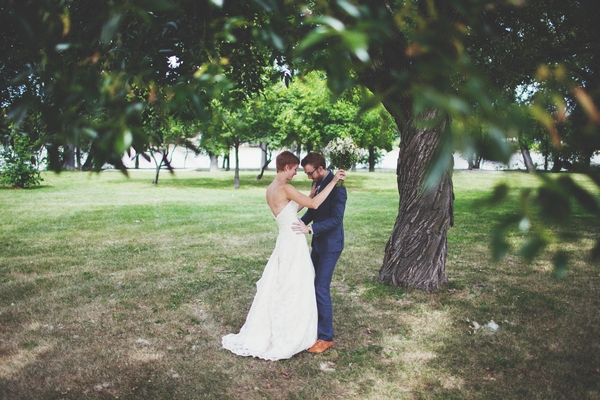 Bride and groom under a tree - Picture by Josh Dookhie Photography