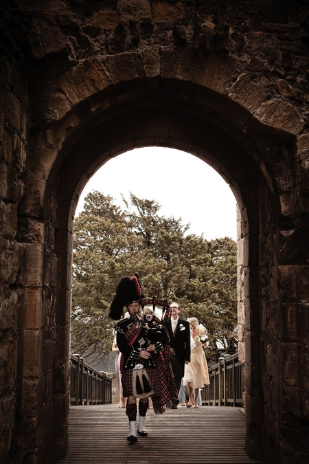 Bagpipe player leading bride and father to wedding - Picture by Archibald Photography
