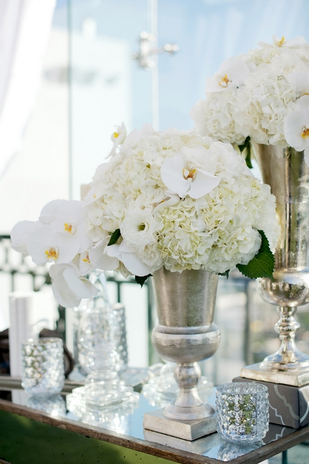Silver vase of wedding flowers - Picture by Yvette Roman Photography