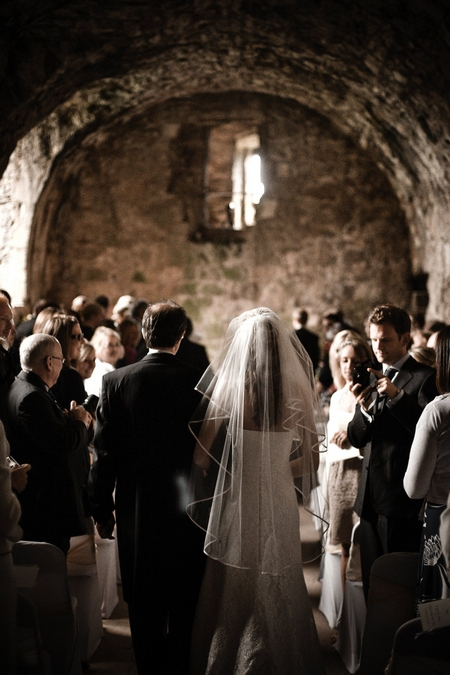 Bride approaching altar at Dirleton Castle - Picture by Archibald Photography