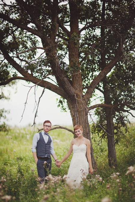 Bride and groom holding hands under a tree - Picture by Josh Dookhie Photography