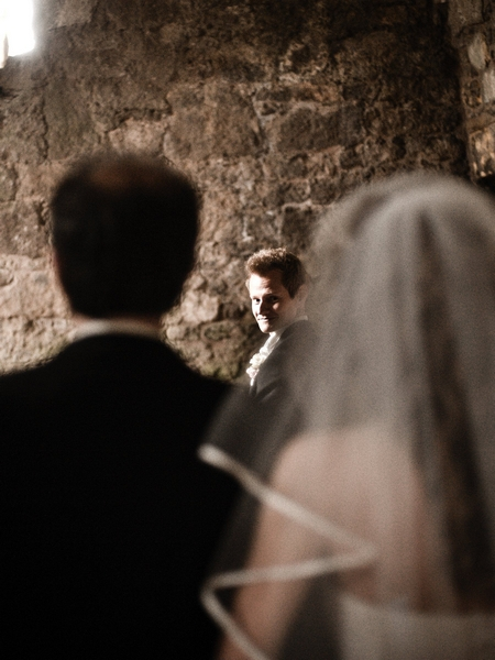 Groom looking round as bride approaches altar - Picture by Archibald Photography