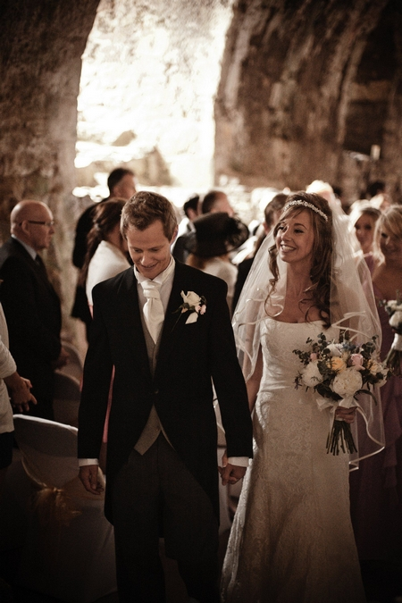 Newly married bride and groom leaving wedding ceremony - Picture by Archibald Photography