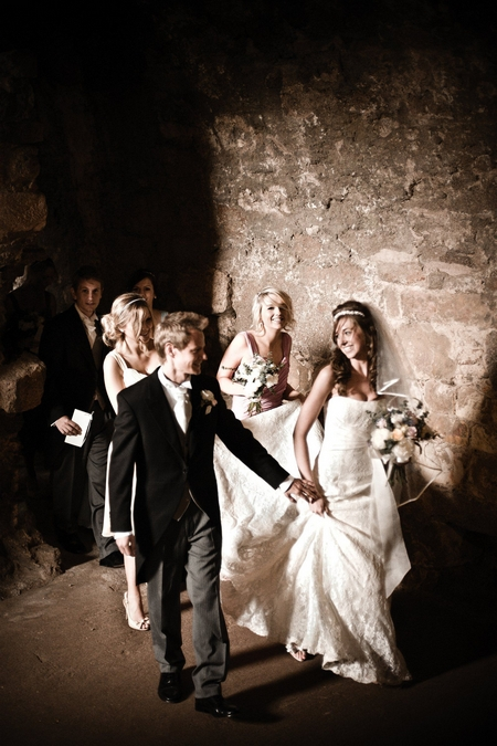 Bridal party leaving wedding ceremony - Picture by Archibald Photography