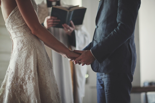 Bride and groom holding hands in wedding ceremony - Picture by Josh Dookhie Photography