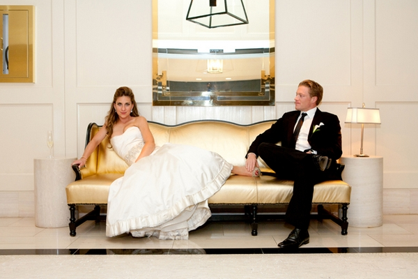 Bride laying on chez lounge with groom - Picture by Yvette Roman Photography
