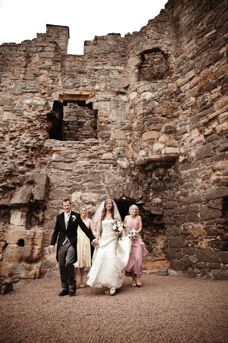 Bridal party leaving ceremony room at Dirleton Castle - Picture by Archibald Photography