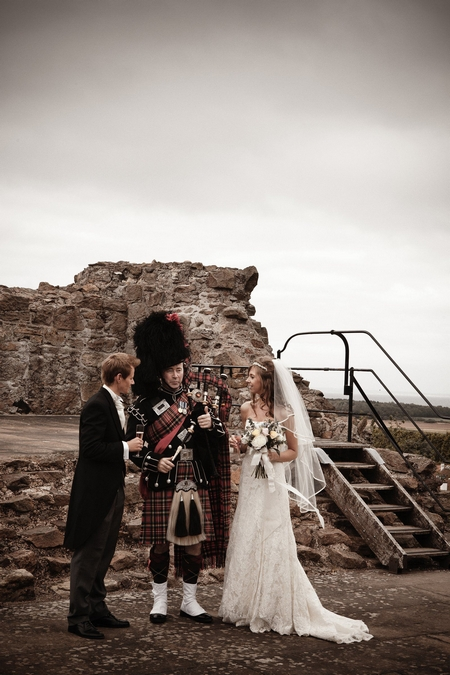 Bride and groom with bagpipe player - Picture by Archibald Photography