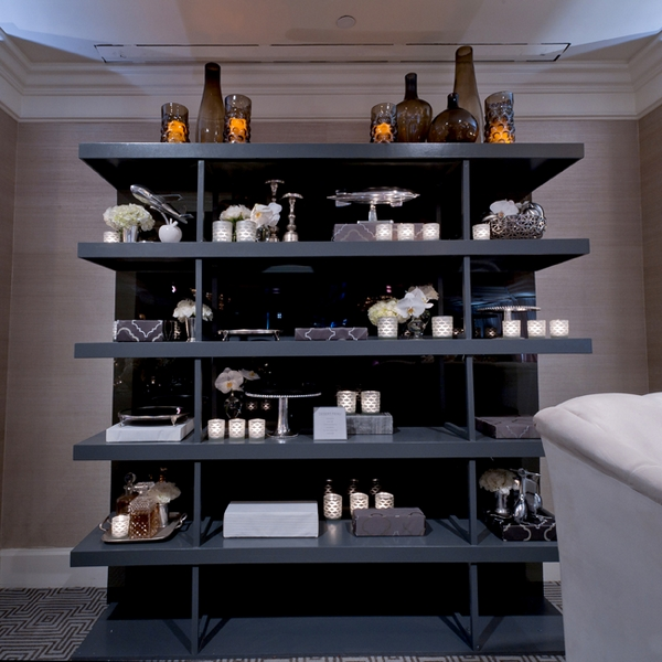 Shelves of wedding decorations - Picture by Yvette Roman Photography