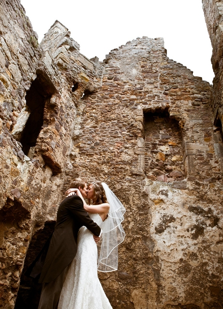 Bride and groom kissing at Dirleton Castle - Picture by Archibald Photography