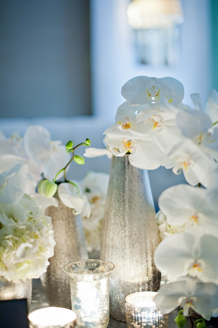Orchid wedding table flowers - Picture by Yvette Roman Photography
