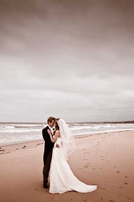 Bride and groom on beach - Picture by Archibald Photography