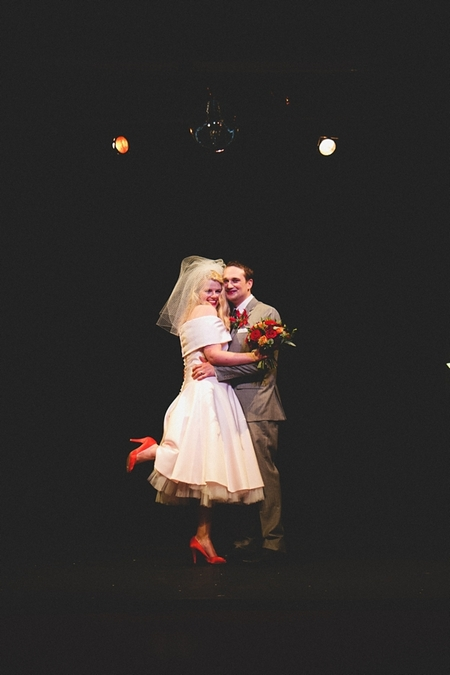 Bride and groom smiling on stage at The Lantern Theatre - Picture by McKinley-Rodgers Photography