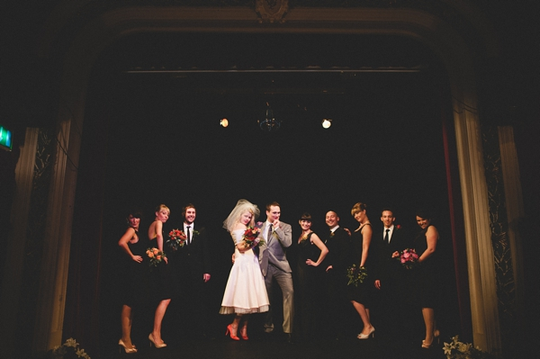 Bridal party posing on stage at The Lantern Theatre - Picture by McKinley-Rodgers Photography