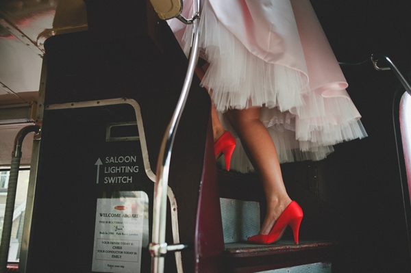Bride's red shoes as she walks up steps on bus - Picture by McKinley-Rodgers Photography
