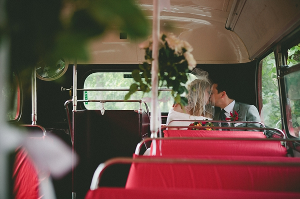 Bride and groom kiss on back seat of bus - Picture by McKinley-Rodgers Photography