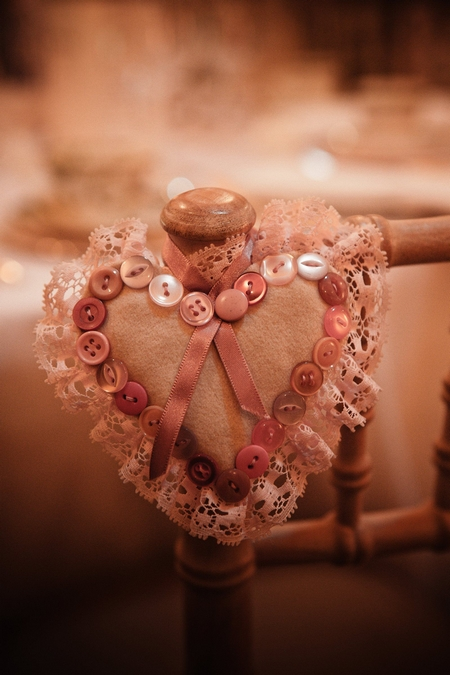Embroidered button heart on back of chair - Picture by Archibald Photography
