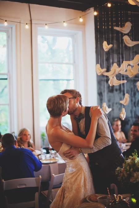 Bride and groom kiss at wedding reception - Picture by Josh Dookhie Photography