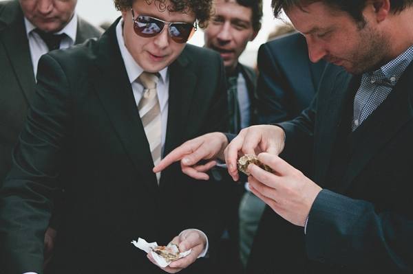 Wedding guests eating oysters - Picture by McKinley-Rodgers Photography