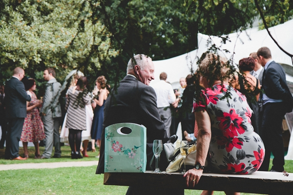 Wedding guests sitting in garden of The Wood Lane Countryside Centre - Picture by McKinley-Rodgers Photography