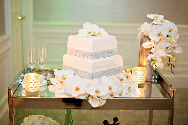 Wedding cake and orchids - Picture by Yvette Roman Photography