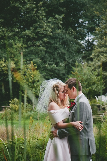 Bride and groom touching noses - Picture by McKinley-Rodgers Photography