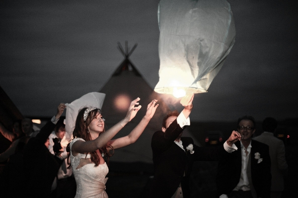 Bride and groom releasing Chinese lantern - Picture by Archibald Photography