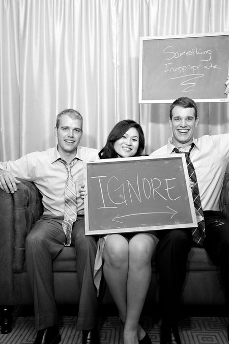 Wedding guests with chalk board message - Picture by Yvette Roman Photography