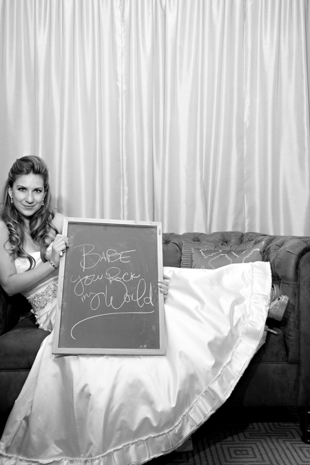 Bride with chalk board message - Picture by Yvette Roman Photography