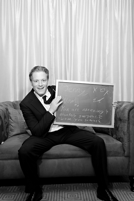 Groom with chalk board message - Picture by Yvette Roman Photography
