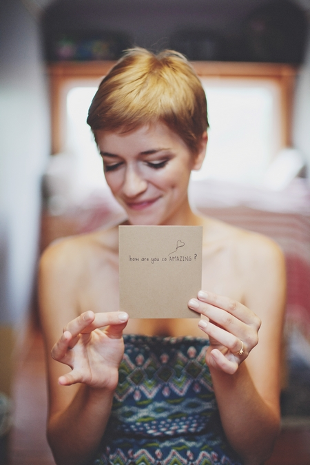 Bride holding card saying How are you so amazing? - Picture by Josh Dookhie Photography