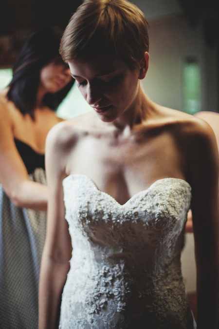 Bride putting on her wedding dress - Picture by Josh Dookhie Photography