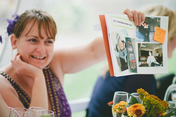 Wedding guest holding up book - Picture by McKinley-Rodgers Photography