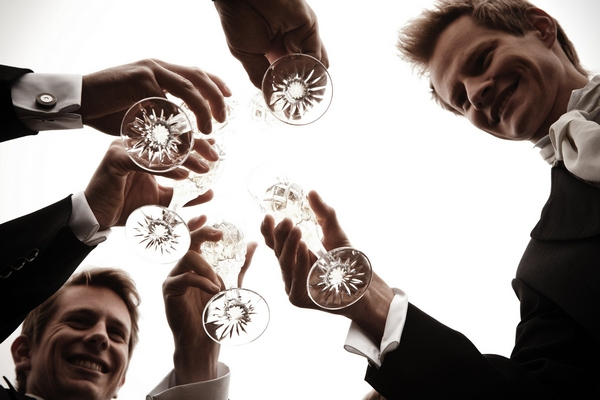 Groomsmen clinking Champagne glasses - Picture by Archibald Photography