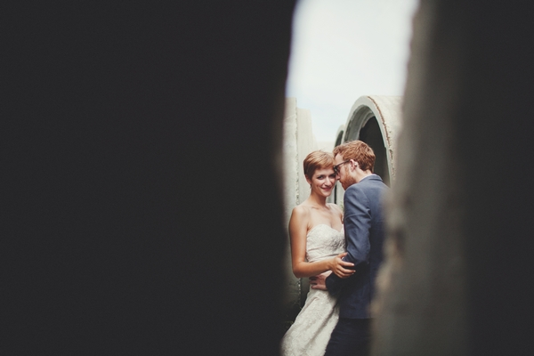 Picture of a bride and groom taken through a gap - Picture by Josh Dookhie Photography