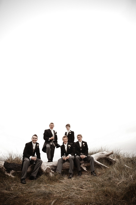 Groomsmen sitting on a fallen tree - Picture by Archibald Photography