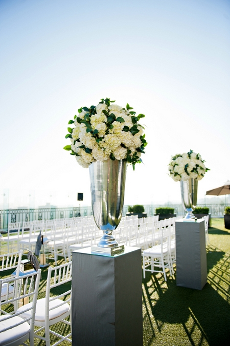 Silver vases of wedding flowers - Picture by Yvette Roman Photography