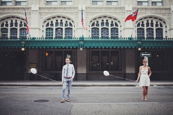 Vintage bride and groom holding balloons - Picture by Josh Dookhie Photography