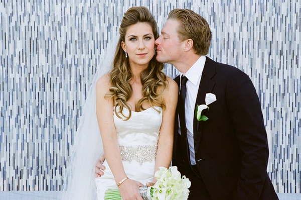 Groom kissing bride on the cheek - Picture by Yvette Roman Photography