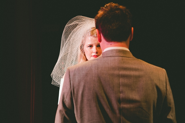 View of bride over groom's shoulder - Picture by McKinley-Rodgers Photography