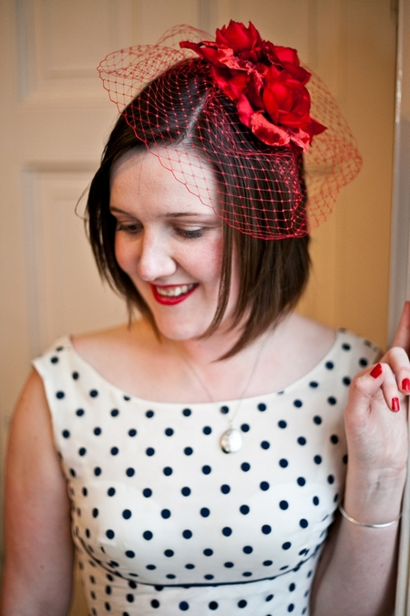 Bride with red birdcage fascinator and blue polka dot dress - Picture by Anneli Marinovich Photography